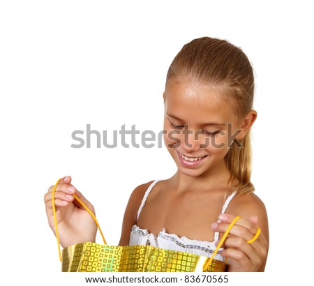 Pretty teenage girl with shopping bags in studio against white background