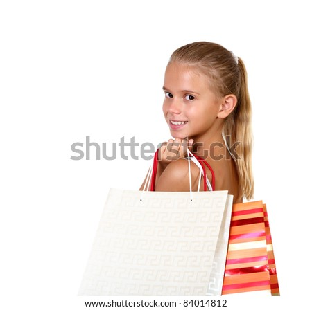 Pretty teenage girl with shopping bags in studio against white background - stock photo