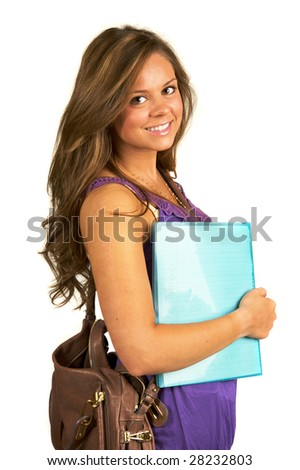 Pretty teenage school girl carrying blue notebook
