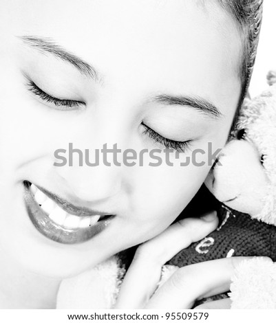 Pretty Teenager Cuddling Her Cute Teddy Bear - stock photo