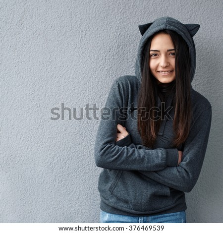 Pretty teenager girl crossed her arms - stock photo