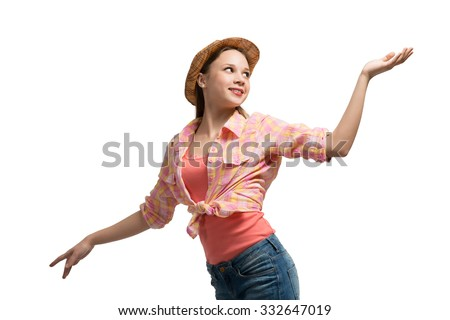 Pretty teenager girl in shots shirt and hat on white background - stock photo