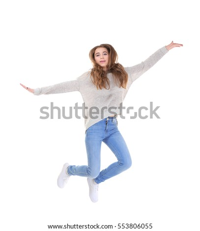 Pretty teenager girl  jumping on white background