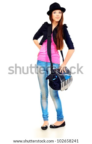 Pretty teenager girl posing at studio. Isolated over white background.