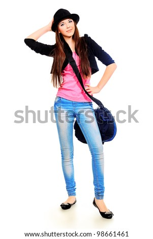 Pretty teenager girl posing at studio. Isolated over white background. - stock photo