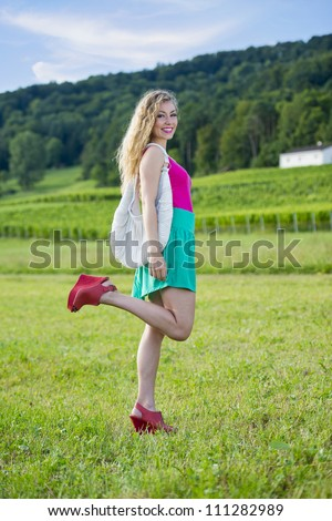 pretty teenager girl posing in front of vineyards