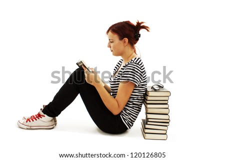 Pretty teenager girl sit on floor and reading book.  on white background - stock photo