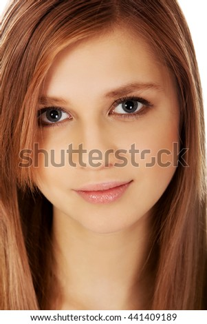 Pretty teenager girl smiling in cheerful mood - stock photo