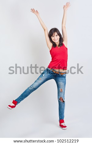 Pretty teenager girl with hands up - stock photo