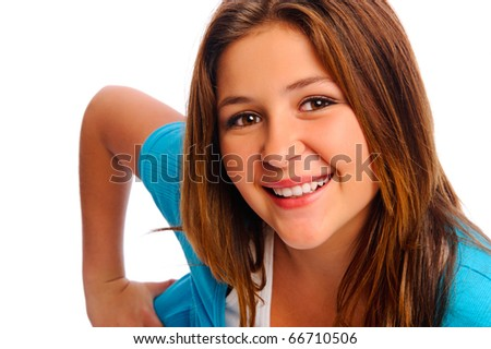 Pretty teenager leans towards camera and smiles for portrait, isolated on white - stock photo