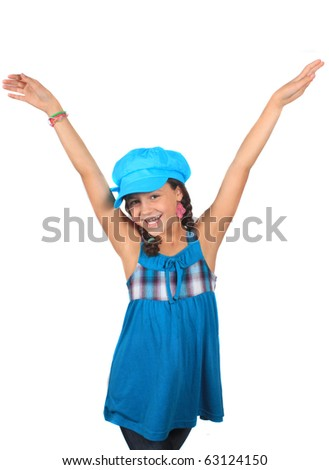 Pretty ten year old adolescent multi ethnic girl with braids on a white background wearing colorful blue hat with arms happily raised up in the air - stock photo