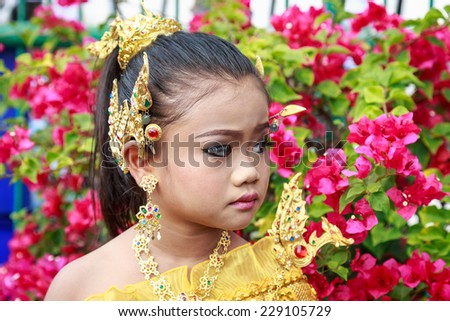 Pretty Thai girl wearing typical Thai dress, identity culture of Thailand - stock photo