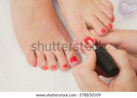 Pretty toes with red nail polish - stock photo