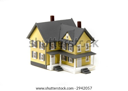 pretty toy home - country in style with 2 stories and a porch - perfect for financial or home improvement use - stock photo