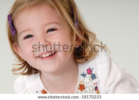 pretty two year old blond girl laughing - stock photo