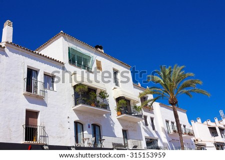 Pretty typical white houses Puerto Banus, Malaga Espa���±a - stock photo