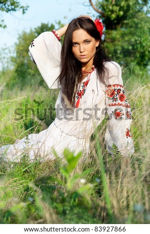 Pretty Ukrainian girl with the midsummer wreath - stock photo