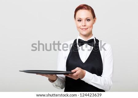 pretty waitress holding an empty tray - stock photo