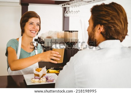 Pretty waitress serving happy customer at the coffee shop - stock photo