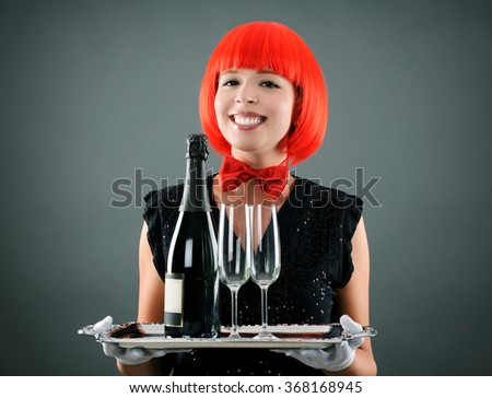 pretty waitress with wine - stock photo