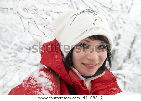 Pretty winter girl in the snow forest