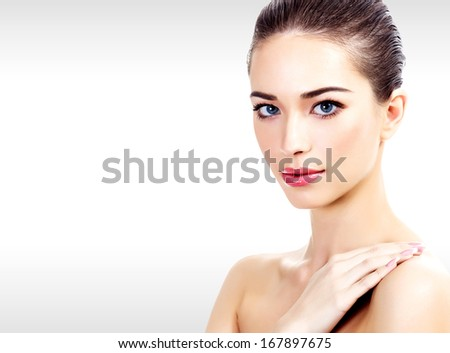 Pretty woman against a grey background, copyspace  - stock photo