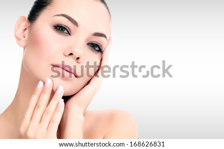 Pretty woman against a grey background with copyspace  - stock photo