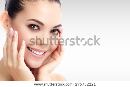 Pretty woman against a grey background with copyspace.