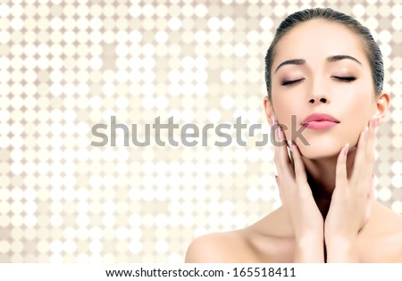 Pretty woman against an abstract background with circles and copyspace  - stock photo