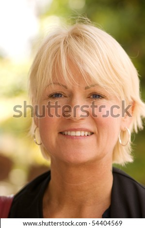 Pretty woman age 52 outside on a beautiful day - stock photo