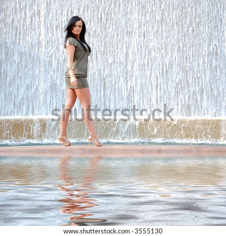 Pretty Woman and Waterfall - stock photo