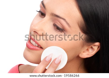 Pretty woman applying make up. Isolated over white background