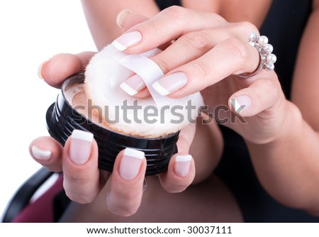Pretty woman applying make up. Isolated over white background - stock photo