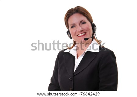 Pretty woman at a call center or service representative using a headset to speak to customers or constituents. - stock photo