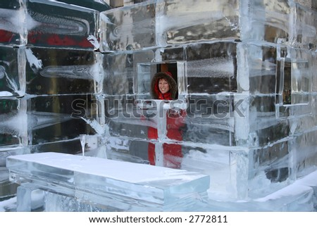 Pretty woman at the bar of an hotel made of ice - stock photo