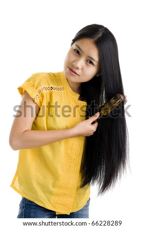 pretty woman brushing her long hair, isolated on white background - stock photo