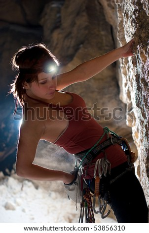 pretty woman climbing on the rock - stock photo