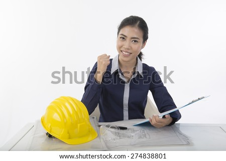 pretty  woman construction worker on working table - stock photo