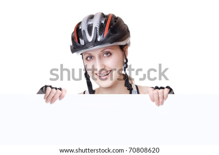 Pretty woman cyclist in a helmet holding a blank sign in front of her - stock photo
