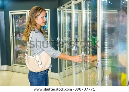 Pretty woman doing her grocery shopping in the supermarket