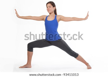 Pretty Woman doing Warrior Yoga Pose - stock photo