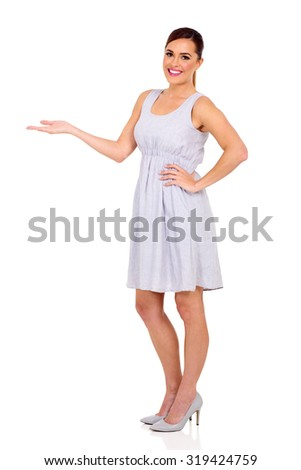 pretty woman doing welcome gesture on white background - stock photo