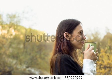 Pretty Woman drinking a hot Drink Outdoor in Madrid - stock photo