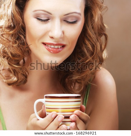 pretty woman drinking coffee - stock photo