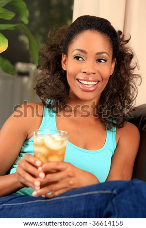 Pretty woman drinking iced tea - stock photo