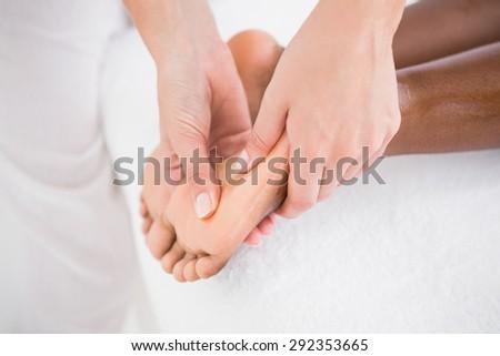 Pretty woman enjoying a foot massage at the health spa - stock photo