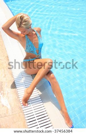 Pretty woman enjoying a swimming pool in Greece - stock photo