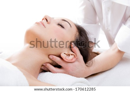 Pretty Woman enjoying  massage at beauty spa