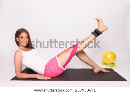 Pretty woman exercise with taped injured leg - stock photo