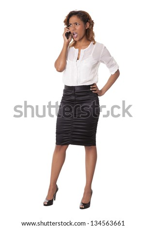 Pretty woman gasps in shock at what she hears on her phone, isolated on white background.